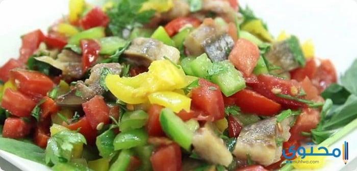 الرنجة بالطماطم والبصل