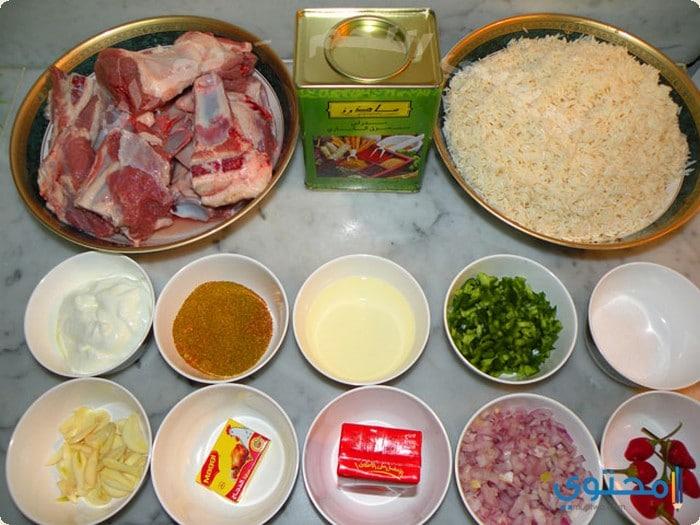 طريقة عمل مندى الدجاج واللحم بالفيديو 13